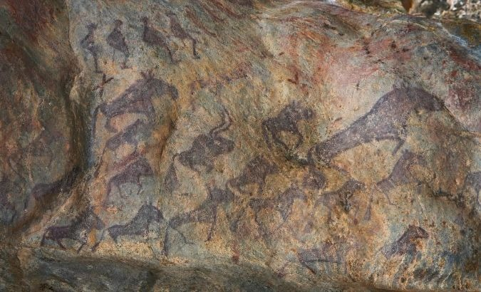 According to Chinese ski historian Shan Zhaojian, archaeologists have dated these paintings as 10,000 to 30,000 years old, They depict people wearing what appears to be skiis and herds of animals walking below them.