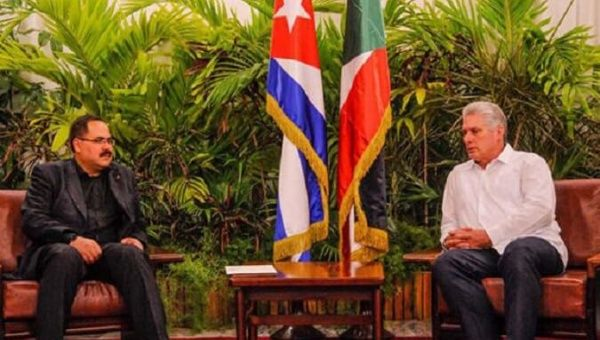 Palestinian Education Minter Sabri Saidam (L) meets with Cuba's Vice President and Miguel Diaz-Canel (R).