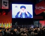 Lebanon's Hezbollah leader Sayyed Hassan Nasrallah is seen on a video screen as he addresses his supporters in Beirut, Lebanon.