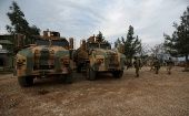 Turkish-backed Free Syrian Army fighters are seen next to military trucks in Northern Afrin countryside, Syria, Feb. 16, 2018.