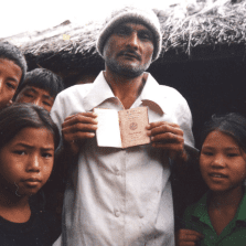 Bhutanese refugees in Beldangi I presenting a Bhutanese passport. It is a legal passport of Bhutan that many Bhutanese Refugees surreptitiously took with themselves when they were forcefully deported from Bhutan.
