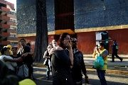 People react after an earthquake shook buildings of the Tlalpan housing project, five months after the Sept. 19 earthquake, in the Educacion neighborhood in Mexico City, Mexico Feb. 16, 2018.