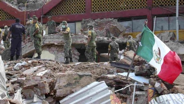 Soldiers remove debris from a partly collapsed municipal building, which was felled by a massive earthquake, in Juchitan, Oaxaca state, Mexico.
