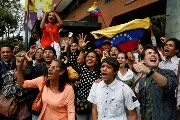 Supporters of Venezuelan evangelical pastor and presidential pre-candidate Javier Bertucci shout as he leaves after a news conference in Caracas, Venezuela, February 21, 2018.