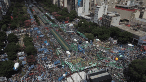 Thousands of protesters take over the main avenue of Buenos Aires - 9 de Julio - taking a stand against the Macri government's massive public sector firings and cuts to social programs amidst a 24 percent inflation rate.