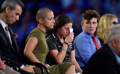 Marjory Stoneman Douglas High School student Emma Gonzalez comforts a classmate during a CNN town hall meeting, at the BB&T Center, in Sunrise, Florida, U.S. Feb. 21, 2018.