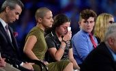 Marjory Stoneman Douglas High School student Emma Gonzalez comforts a classmate during a CNN town hall meeting in Sunrise, Florida, U.S. Feb. 21, 2018.
