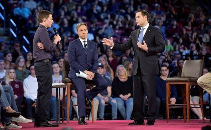 High-school shooting survivor Cameron Kasky (L) asks Senator Marco Rubio if he will continue to accept money from the NRA.