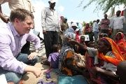Justin Forsyth talks to internally displaced Somalis.
