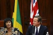 Former British Prime Minister David Cameron (R), who during an official trip to Jamaica said Caribbean people should