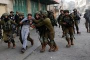 Israeli soldiers detain a Palestinian during clashes at a protest in Hebron, in the occupied West Bank.