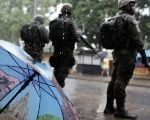 Brazil's armed forces members patrol the working class neighborhood of Vila Kennedy, in Rio de Janeiro.