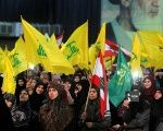 Supporters of Lebanon's Hezbollah listen to leader Sayyed Hassan Nasrallah as he speaks via video link in Beirut.