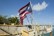 Puerto Rico and U.S. flags.