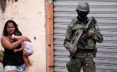 An armed forces member patrols a neighborhood in Rio de Janeiro.