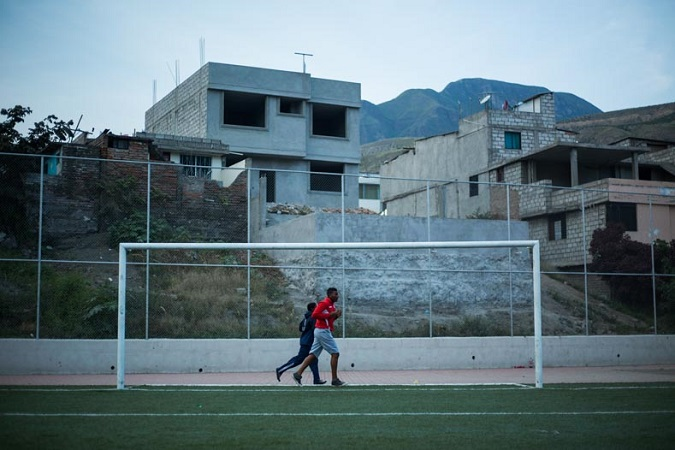 Young soccer players run around the field to warm up for practice in the valley. The region now home to some 20,000 Ecuadoreans was once controlled by seven plantations that together owned over 2,000 slaves.