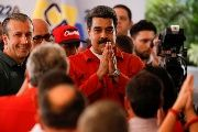 President Maduro gestures as he registers his candidacy for reelection at the National Electoral Council headquarters in Caracas, Venezuela Feb. 27, 2018.