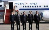 Members of South Korean delegation pose before boarding an aircraft as they leave for Pyongyang at a military airport in Seongnam, South Korea March 5, 2018.
