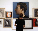 A visitor looks at portraits of Facebook's founder Mark Zuckerberg at solo exhibition