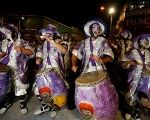 Members of a comparsa, an Uruguayan carnival group, participate in the Llamadas parade, a street fiesta with a traditional Afro-Uruguayan roots, in Montevideo, Uruguay February 10, 2018.