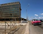 A vintage car drives in front of the U.S. Embassy in Havana, Cuba, March 2, 2018.
