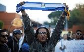 A man holds a Salvadoran flag during a protest against municipal and parliamentary elections results in San Salvador, El Salvador, March 6, 2018.