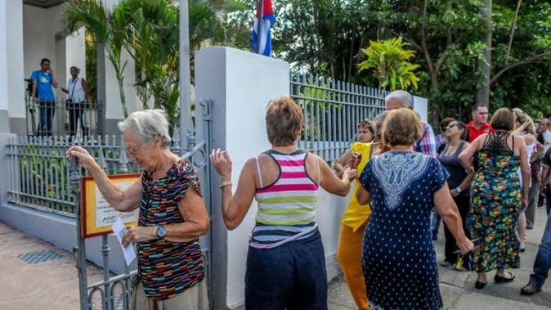 Cubans line up to vote outside polling station.