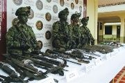 The Colombian army showcases weapons seized during a military operation against the ELN in which 10 rebels were killed. March 6, 2018.