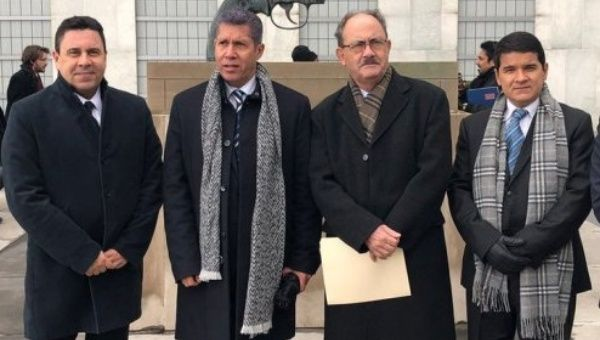 Venezuelan ambassador Samuel Moncada, left, with opposition presidential candidate Henri Falcon, second from left, following their meeting in New York on Tuesday.
