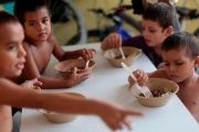 Children have a meal in Mexico.