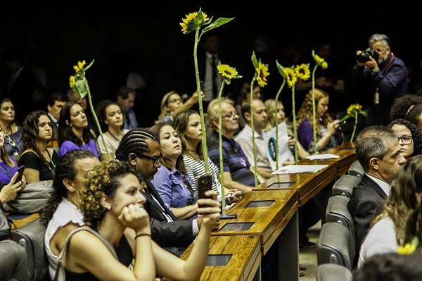 Parliamentarians carried flowers as they sat on the congress.
