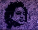 Stencil art depicting murdered Rio de Janeiro city councilor Marielle Franco on the wall of the city council chamber.