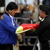 President Evo Morales hands a flag to Navy Commander Real Admiral Javier Ayllon during maritime flag day March 10.
