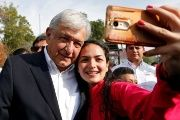 Andres Manuel Lopez Obrador, candidate of the National Regeneration Movement, takes a selfie after offering a floral tribute to the 80th anniversary of the expropriation of Mexico's oil industry at Lazaro Cardenas monument in Mexico City, March 18, 2018.