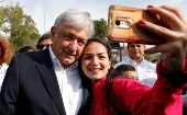 Andres Manuel Lopez Obrador, candidate of the National Regeneration Movement, takes a selfie after offering a floral tribute to the 80th anniversary of the expropriation of Mexico