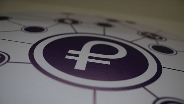 "The new Venezuelan cryptocurrency ""Petro"" logo is seen at a facility of the Youth and Sports Ministry in Caracas, Venezuela Feb. 23, 2018."