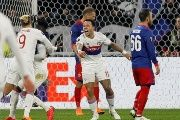 Lyon's Maxwel Cornet celebrates with Mariano and Memphis Depay after scoring their first goal during the game Olympique Lyonnais vs CSKA Moscow on March 15, 2018