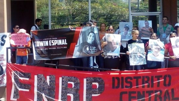 Members of the Honduras Solidarity Network protest outside the office of the Public Prosecutor in Honduras
