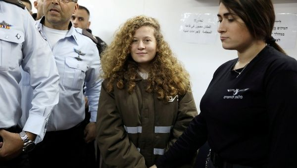 Palestinian teen Ahed Tamimi enters a military courtroom at Ofer Prison, near the West Bank city of Ramallah, January 15, 2018.