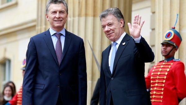 Mauricio Macri and Juan Manuel Santos say they will skip the summit if Peru does not resolve its political crisis.