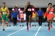 Jamaica's Asafa Powell (C) held the world 100-meter record for three years between 2005 and 2008 at 9.77 and 9.74 seconds.
