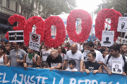 Demonstrators carry the number 30,000 to represent the victims detained or forcibly disappeared under the military dictatorship.
