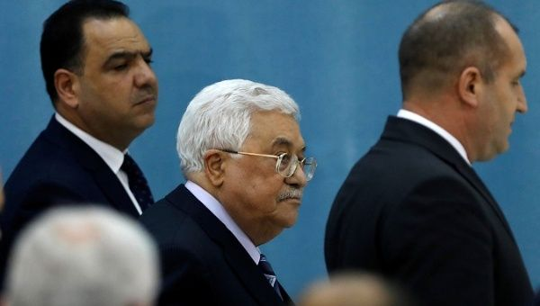 Palestinian President Mahmoud Abbas walks out after a news conference with Bulgarian President Radev in Ramallah, in the West Bank March 22, 2018.