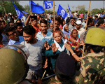 Police try to stop people belonging to the Dalit community as they take part in a protest during a nationwide strike called by Dalit organizations, April 2, 2018.