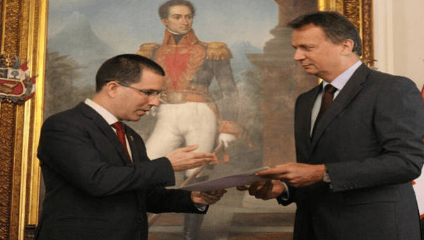 Venezuelan Foreign Minister Jorge Arreaza hands letter to the head of negotiations of the Swiss Confederation, Didier Chassot, demanding the Swiss government ends the economic sanctions placed on Venezuela last week be lifted