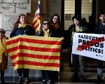Supporters of ousted Catalan leader Puigdemont and his government are pictured outside Brussels Palace of Justice.