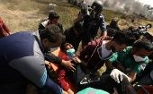 Medics evacuate wounded man in Gaza.