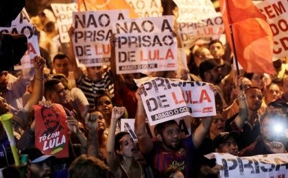 "Supporters of former Brazilian President Luiz Inacio Lula da Silva protest against the ordered Lula to turn himself into police. The signs read; ""No prison for Lula."""