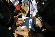 Journalist Yaser Murtaja is evacuated after being shot by an Israeli sniper.