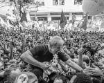 Former Brazilian President Lula is hoisted by supporters after speaking at the ABC Steelworkers Union headquarters.